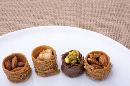 Nut stuffed dessert of mini size cuisine on a plate