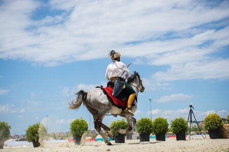 Ottoman horseman in his ethnic clothes riding on his horse Stock Photo