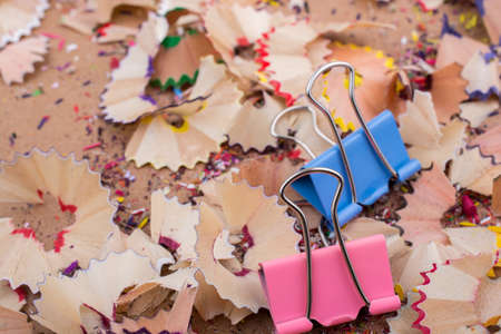 Colorful clips placed on a  pencil shavings Stock Photo
