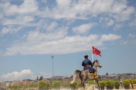 Ottoman horseman in his ethnic clothes riding on his horse Editorial
