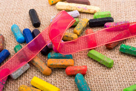 Used crayons of various color  wirh a ribbon Stock Photo