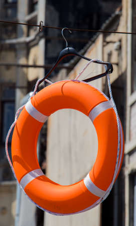 Life preserver or life saver hanging in air Stock Photo