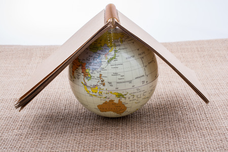 Globe is placed on canvas background