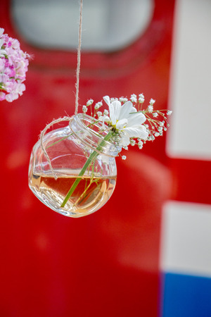 Herbal tea bottle with flowers hanging on string