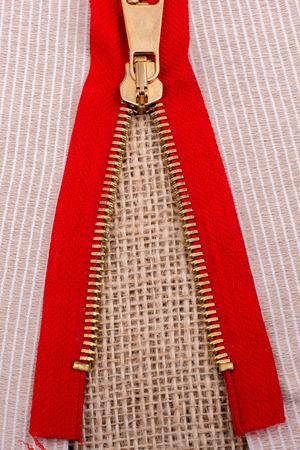 metal fastener: Closeup of a colorful  zipper on linen canvas