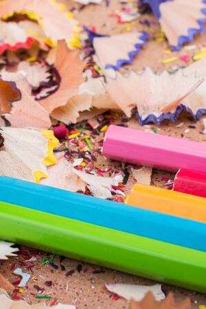 Color Pencils over a notebook with pencil shavings Stock Photo