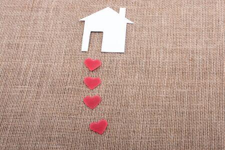 Model house and a heart shape beside it