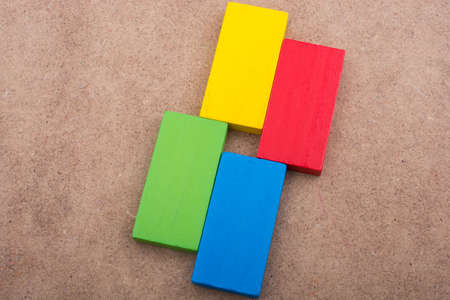 rectangle: Wooden blocks on a brown background