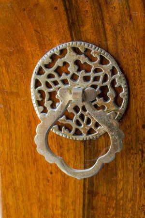 door handle: Old Handmade ottoman door knob on wood