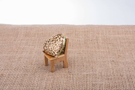 Little heart shape on a chair on canvas Stock Photo