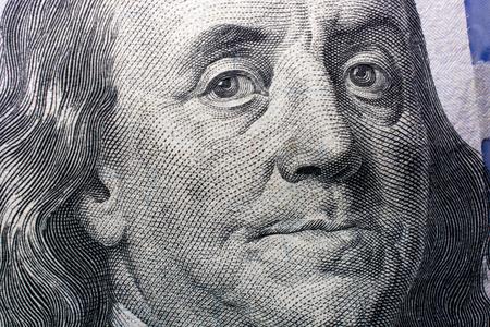 Close up of Benjamin Franklin face on 100 US dollar bill