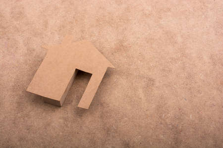 figurines: Little paper houses on a brown background