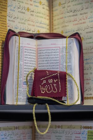 Islamic Holy Book Quran  on the market shelf Editorial