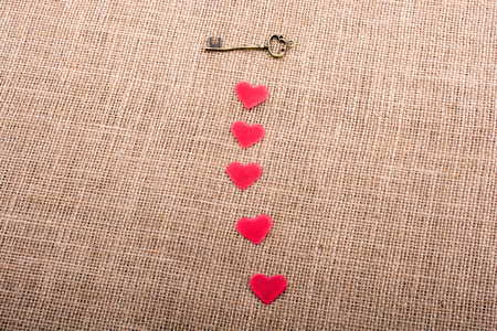 Retro styled key and heart shapes objects on a canvas