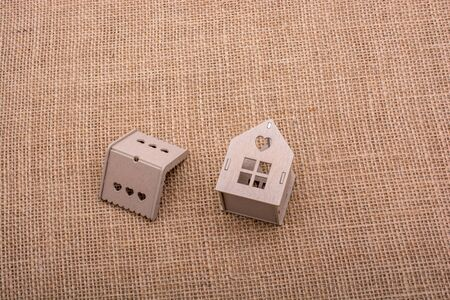 figurines: Little model house placed on a linen canvas Stock Photo