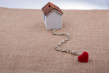 Model house and chain with a heart on canvas