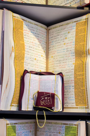 coran: Islamic Holy Book Quran  on the market shelf Stock Photo