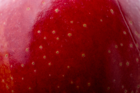 Red apple with dots in close up view