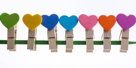 Colorful clothespin attached attached on a line side by side Stock Photo