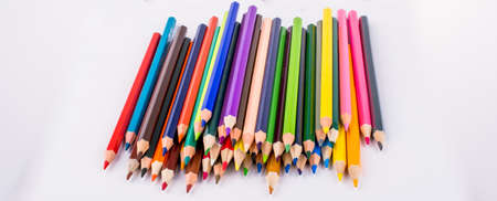 Color pencils and back to school title on a notebook Stock Photo