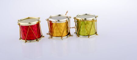 Little colorful toy drums  on a white background
