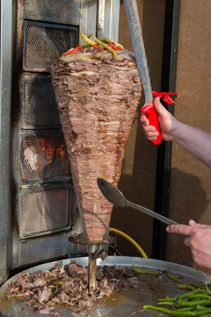 Traditional Turkish Doner Kebab on pole Stock Photo - 91256102
