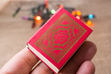 Holy Book Quran with lights behind Stock Photo