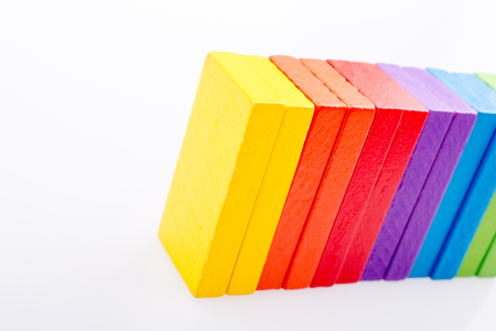 Colorful Domino Blocks in a line on a white background
