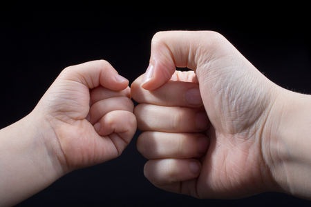 Hand closed for a fist gesture in black