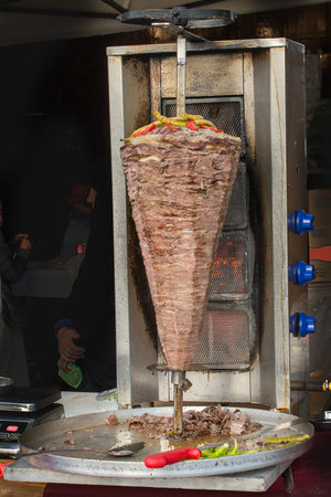 Traditional Turkish Doner Kebab on pole Stock Photo - 98013341