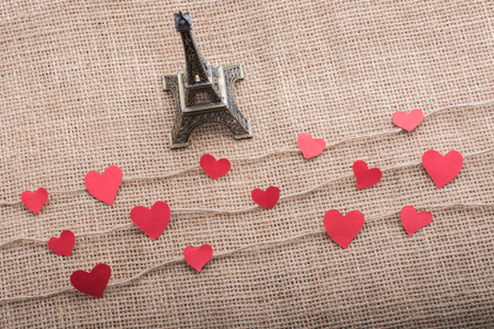 Love concept with Eiffel tower and paper heart on threads Imagens