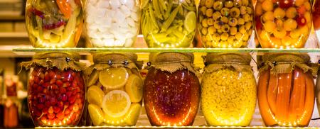Homemade  marinated pickles variety preserving jars