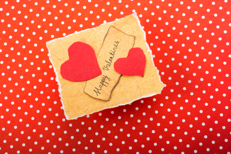 Love icon and Valentines day wording on torn paper Stock Photo