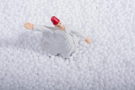 Sufi Whirling Dervish on little  white polystyrene foam balls