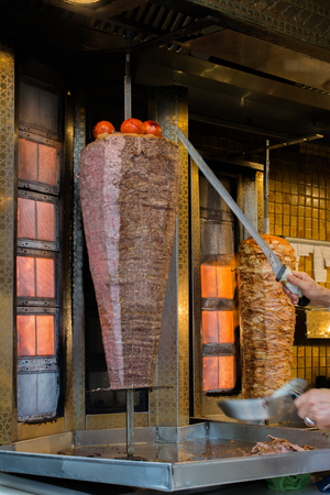 Traditional Turkish Doner Kebab on pole Stock Photo - 98279834