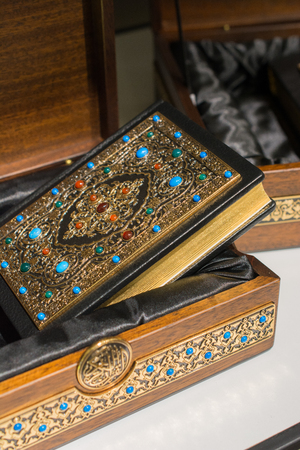 Holy Book Quran with decorative cover and  box Stock Photo