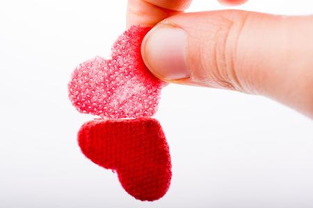 Heart shaped object in hand on canvas