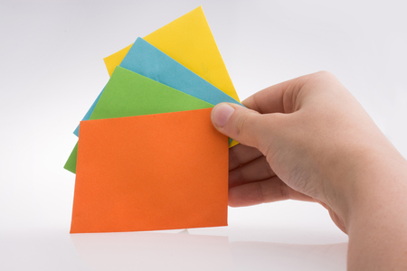 Hand holding colorful envelops on a white background Stock Photo