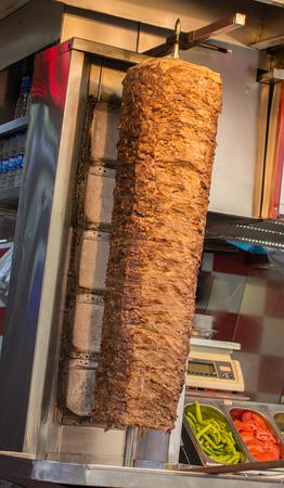 Traditional Turkish Doner Kebab on pole Stock Photo - 100228634