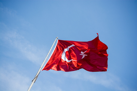 Turkish national flag hang on a pole in open air Reklamní fotografie