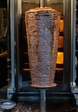 Traditional Turkish Doner Kebab on pole Stock Photo - 100699155