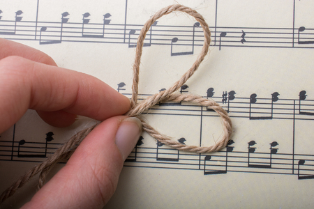linen thread is placed on paper with musical notes