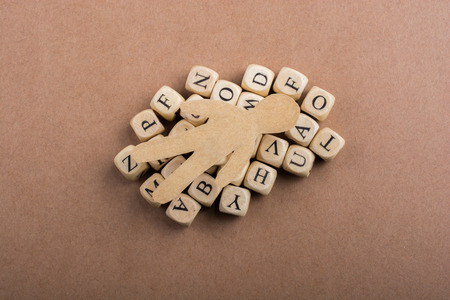Paper man and letter cubes of made of wood