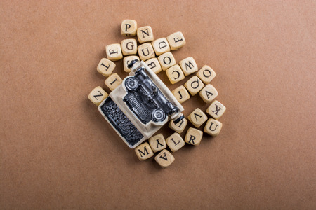 Letter cubes of made of wood around model typewritter Stock Photo