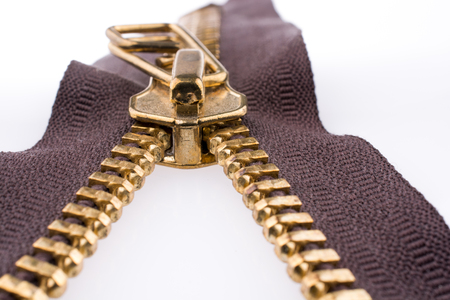 Close up or macro of a  brown zipper on white background