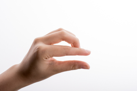 Hand measuring on a white background Stock fotó