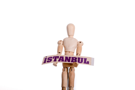 Wooden man holding Istanbul sign on a white background Stock Photo