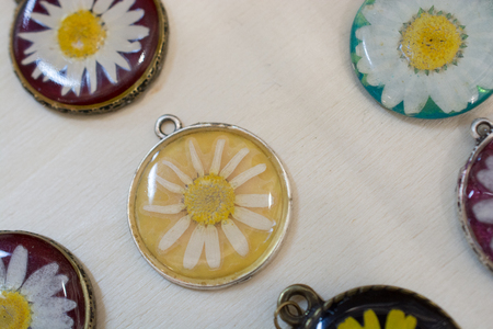 pendant with beautiful dry  flower inside resin