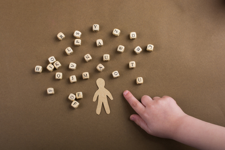 Letter cubes of made of wood  and man figurine Stock fotó