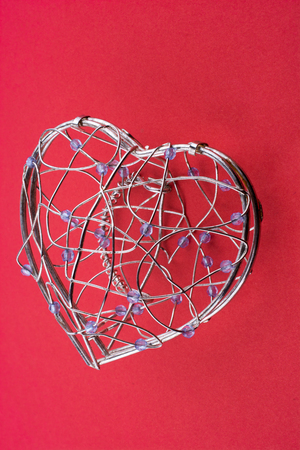 Heart cage on a red background Stock Photo